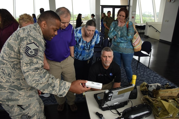 Master Sgt. Frederick, 335th Training Squadron career development course writer, briefs educators on field weather equipment at the Weather Training Complex during a NASA Educator Workshop, March 30, 2017, on Keesler Air Force Base, Miss. NASA teamed up with 335th TRS weather instructors and the 403rd Wing Hurricane Hunters to provide teachers from Mississippi and Louisiana with available resources, techniques and best practices for use in their classrooms. (U.S. Air Force photo by Kemberly Groue)