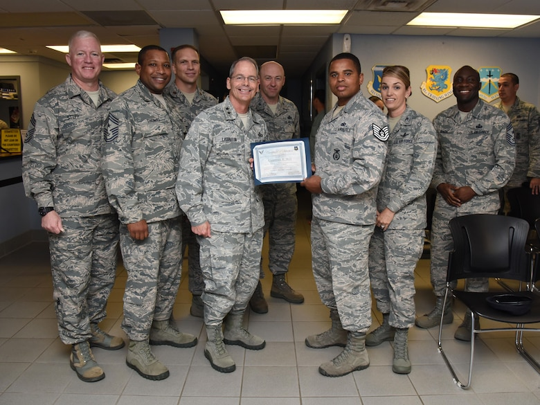 Maj. Gen. Bob Labrutta, 2nd Air Force commander and Staff Sgt. Courtney Hill, 81st Security Forces Squadron pass and ID NCO in charge, poses for a photo with base leadership during a Stripes for Exceptional Performers promotion ceremony at the visitors center March 30, 2017, on Keesler Air Force Base, Miss. Hill was STEP promoted to the rank of technical sergeant. In the past year, Hill oversaw the issue of 20,000 passes and coordinated entry for multiple base events. His hard work and dedication was acknowledged when he won 81st Mission Support Group NCO of the year for 2016. (U.S. Air Force photo by Kemberly Groue)