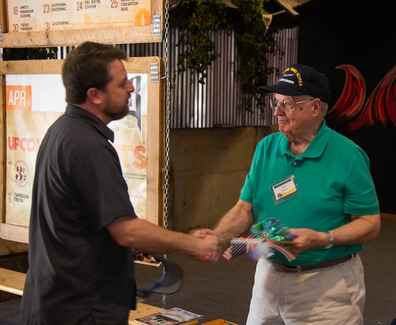 Jared Belville (left), Red River Brewing Co. managing partner, and John Roach (right), Korean War 307th Bombardment Group veteran, shakes hands during a tour of the Red River Brewing Co. in Shreveport, La., March 30, 2017. The 307th Bomb Wing celebrated their 75th Anniversary by taking alumni on a tour of Shreveport and Bossier City La, and hosting a gala to honor its bomber heritage. (U.S. Air Force photo by Staff Sgt. Jason McCasland/Released)