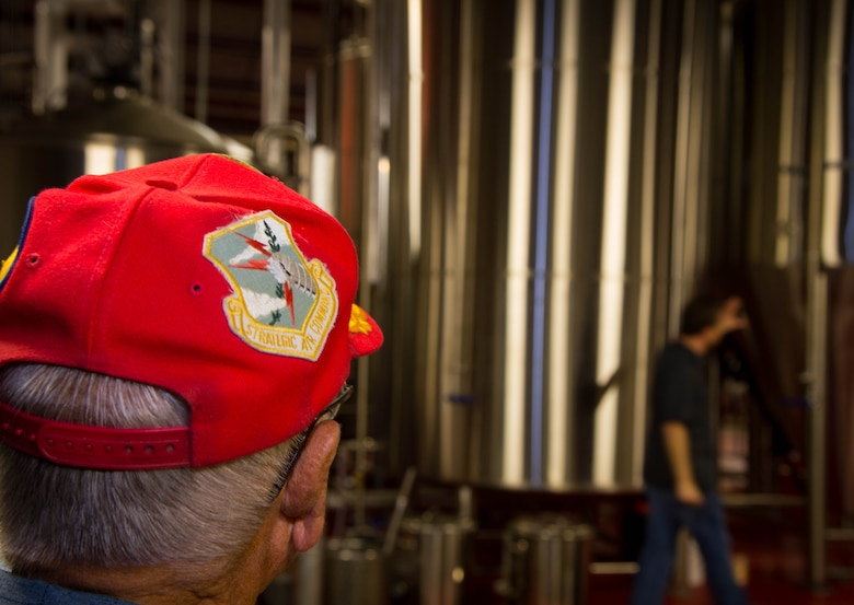 A 307th Bomb Wing veteran, looks at storage tanks used for brewing beer at the Red River Brewing Co. Shreveport, La., March 30, 2017. The 307th Bomb Wing was originally under Strategic Air Command in 1954 at Lincoln Air Force Base, Nebraska. While at Lincoln, the 307th functioned as a Combat Ready Unit, conducting combat training missions and maintaining an alert force commitment, both at Lincoln and overseas bases, until its deactivation on March 25, 1965. (U.S. Air Force photo by Staff Sgt. Jason McCasland/Released)