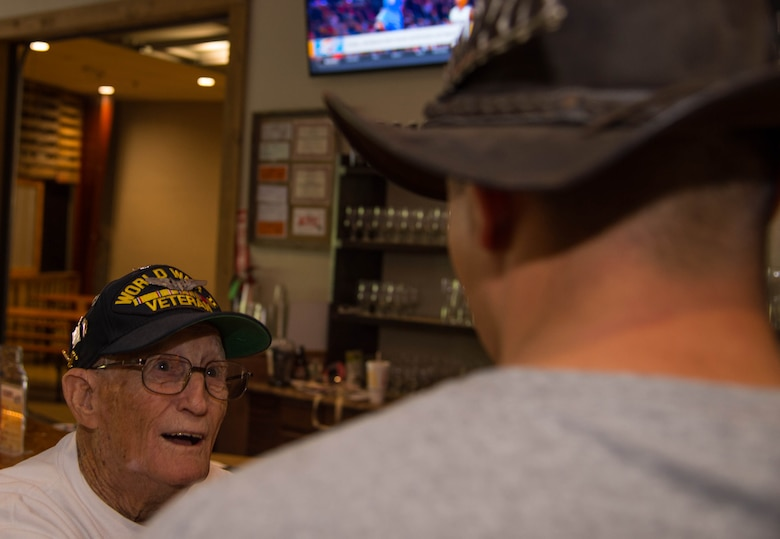 "Dale Stickrath, World War II 307th Bombardment Group veteran, trades stories with another veteran at the Red River Brewing Co. Shreveport, La., March 30, 2017. In 1942, 27 B-24 Liberators from the 307th Bombardment Group took part in one of the longest mass-raids of that era which earned them the name ""The Long Rangers."" The now, 307th Bomb Wing celebrated their 75th Anniversary with alumni from wars such as World War II, Korean War, Vietnam and Operation Inherent Resolve. (U.S. Air Force photo by Staff Sgt. Jason McCasland/Released)"