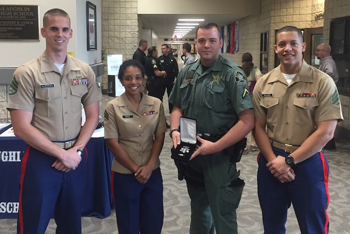 Future Marine Zachary Barr is awarded the lifesaving medal Mar. 23, 2017 after resuscitating a criminal on the run from police who had fallen into a lake and drowned. Barr is currently servicing as a field training officer with the Pasco County Sheriff's department. Barr entered the Marine Corps delayed entry program Nov. 23, 2016, and ships out in May 2017. (Courtesy photo)