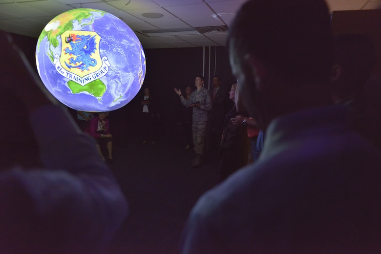 Capt. Caleb Tynes, 335th Training Squadron instructor supervisor, briefs 81st Training Wing honorary commanders on the Science on a Sphere planetary training aid at the Weather Training Complex, Mar. 30, 2017, on Keesler Air Force Base, Miss. The visit highlighted the training mission of the 81st Training Group for 81st TRW honorary commanders. (U.S. Air Force photo by Andre' Askew)