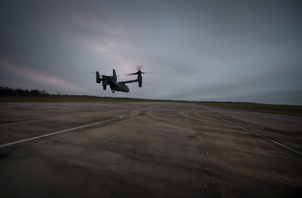 A CV-22 Osprey descends on the Landing Helicopter Deck at Duke Field, Fla., April 3, 2017. This was the first step in an effort to utilize the LHD as part of a pre-deployment requirement for CV-22 aircrew to be deck qualified. In previous years, members of the 8th Special Operations Squadron and 8th Aircraft Maintenance Unit would travel to various locations multiple times a year to gain aircraft carrier qualification.  (U.S. Air Force photo by Senior Airman Krystal M. Garrett)