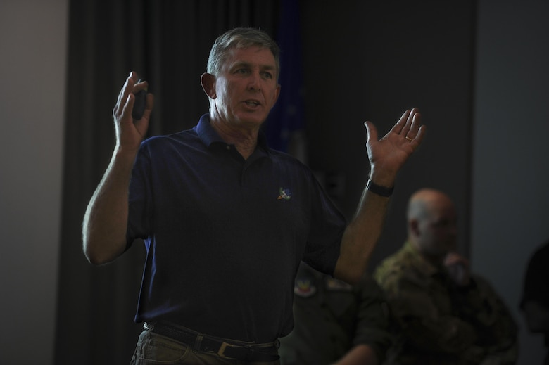 Bill Walters, a program analyst with Air Force Special Operations Command, speaks during the celebration of the 50th Anniversary of the AC-130 at Hurlburt Field, Fla., March 31, 2017. The 4th Special Operations Squadron celebrated the 50th anniversary of the AC-130's Air Force career by sharing a brief history of the aircraft, hosting a barbecue and a facilitating a tour of the AC-130J Ghostrider gunship. (U.S. Air Force photo by Airman 1st Class Dennis Spain)