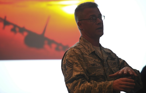 Chief Master Sgt. Gregory Smith, the command chief of Air Force Special Operations Command, speaks during the celebration of the 50th Anniversary of the AC-130 at Hurlburt Field, Fla., March 31, 2017. Smith spoke on the importance the gunship has on the battlefield and the importance of the aircraft's evolution in achieving air superiority. (U.S. Air Force photo by Airman 1st Class Dennis Spain)