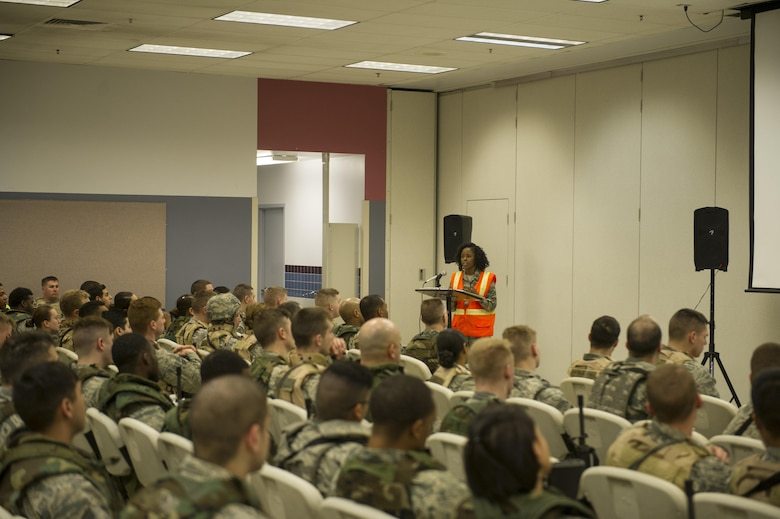 U.S. Air Force Capt. Victoria Honey, a 354th Fighter Wing Staff Judge Advocate assistant staff judge advocate, gives a legal brief to Airman who are simulated deploying in support of exercise Arctic Gold 17-5, April 4, 2017, at Eielson Air Force Base, Alaska. During the brief Honey went over the Law of Armed Conflict and some of the services available to Airman who are simulated deploying and their families. (U.S. Air Force photo by Airman 1st Class Isaac Johnson)