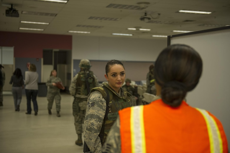 U.S. Air Force Senior Airman Emily Hnatiuk, a 354th Force Support Squadron sports director, speaks to a representative from food services April 4, 2017, at Eielson Air Force Base, Alaska. Food services along with several other base agencies was present during the simulated chalk lines to help provide a realistic experience for the participants of Arctic Gold 17-5. (U.S. Air Force photo by Airman 1st Class Isaac Johnson)