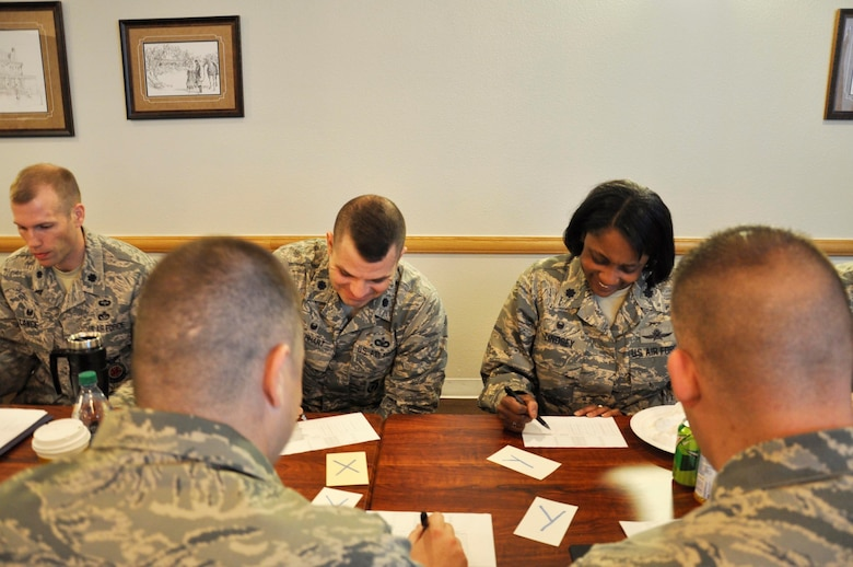 Lt. Col. Lashauna Lindsey, 341st Communications Squadron commander, compares notes with a fellow commander during a group activity at the 20th Air Force Senior Leader Conference on F.E. Warren Air Force Base, Wyo., March 30, 2017. Squadron commanders from across 20th AF who attended were able to share ideas and network during the event. The 20th AF SLC focused on revitalizing the squadron as a core fighting unit, a major focus area of Gen. David L. Goldfein, Air Force Chief of Staff.  (U.S. Air Force photo 1st Lt Veronica Perez)