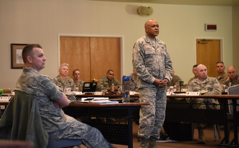 Maj. Gen. Anthony Cotton, 20th Air Force and Task Force 214 commander, watches a leadership clip during the 20th AF Senior Leader Conference on F.E. Warren Air Force Base, Wyo., March 30, 2017. Cotton empowered squadron commanders in attendance to innovate within their units and share ideas on how to take care of their Airmen. The 20th AF SLC focused on revitalizing the squadron as a core fighting unit, a major focus area of Gen. David L. Goldfein, Air Force Chief of Staff.  (U.S. Air Force photo by Glenn Robertson)
