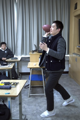 A student at Ocheon high school throws a football May 30 during an American culture class in Pohang, South Korea. Marines and sailors withCombat Logistics detachment 333, Combat Logistics Battalion 4, Combat Logistics Regiment 3, 3rd Marine Logistics Group, III Marine Expeditionary Force, led classes on American sports, hobbies and music while working with students to improve their English skills. The service members spent a week at the school to ensure all the students had an opportunity to talk with them. (U.S. Marine Corps photo by Cpl. Jessica Collins)