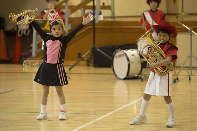 Japanese students from the Shunan International Children's Club perform during the Japanese Cultural Exchange Program at Marine Corps Air Station Iwakuni, Japan, March 20, 2017.  The Shunan International Children's Club traveled to the air station to give the students an opportunity to experience Japanese singing, dancing and martial arts. (U.S. Marine Corps photo by Pfc. Stephen Campbell)