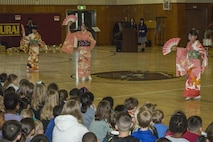 "Japanese children from the Shunan International Children's Club perform the ""Sakura Dance"" during the Japanese Cultural Exchange Program at Marine Corps Air Station Iwakuni, Japan, March 20, 2017. The ""Sakura Dance"" is a traditional dance depicting the season of cherry blossoms in Japan and demonstrates their unique culture. (U.S. Marine Corps photo by Pfc. Stephen Campbell)"