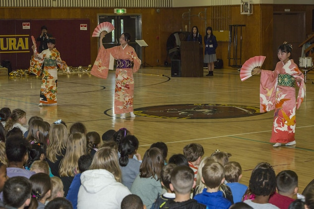 """Japanese children from the Shunan International Children's Club perform the """"Sakura Dance"""" during the Japanese Cultural Exchange Program at Marine Corps Air Station Iwakuni, Japan, March 20, 2017. The """"Sakura Dance"""" is a traditional dance depicting the season of cherry blossoms in Japan and demonstrates their unique culture. (U.S. Marine Corps photo by Pfc. Stephen Campbell)"""