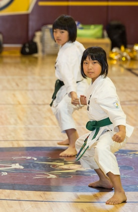 Japanese children from the Shunan International Children's Club demonstrate karate during the Japanese Cultural Exchange Program at Marine Corps Air Station Iwakuni, Japan, March 20, 2017. The Shunan International Children's Club traveled to the air station to give the students an opportunity to experience Japanese singing, dancing and martial arts. (U.S. Marine Corps photo by Pfc. Stephen Campbell)