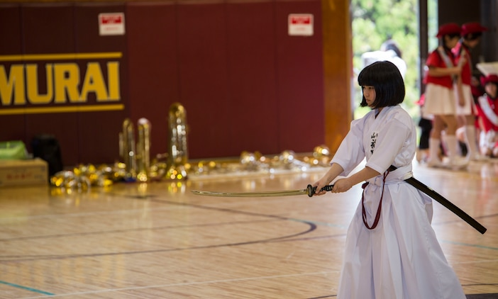 A Japanese child from the Shunan International Children's Club demonstrates laido, an ancient Japanese martial art, with an imitation sword during the Japanese Cultural Exchange Program at Marine Corps Air Station Iwakuni, Japan, March 20, 2017. The Shunan International Children's Club traveled to the air station to give the students an opportunity to experience Japanese singing, dancing and martial arts. (U.S. Marine Corps photo by Pfc. Stephen Campbell)