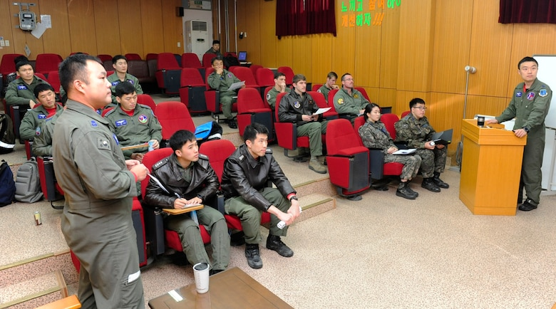 U.S. Air Force and Republic of Korea Air Force pilots attend a briefing at Seosan Air Base, Republic of Korea during Buddy Wing 17-3, March 30, 2017. Combined exercises, like Buddy Wing, reinforce the ROK-U.S. alliance and demonstrates one of many alliance capabilities available for the defense of the Republic of Korea. (U.S. Air Force photo/Staff Sgt. Chelsea Sweatt)