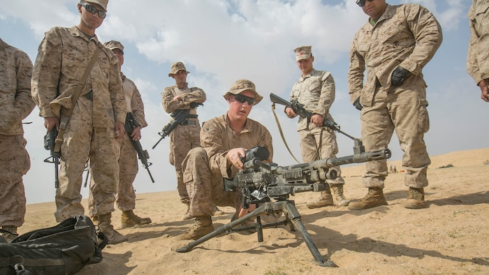 Lance Cpl. Alexander Seick, a communications specialist with Combat Logistics Battalion 11, 11th Marine Expeditionary Unit (MEU), closes the feed tray of an M240B medium machine gun after conducting a functions check during a sustainment training exercise near Camp Beuhring, Kuwait, March 5. Marines can use the M240B's high rate of fire to provide suppressive fires, subduing enemy threats while moving toward an objective. The 11th MEU is currently supporting U.S. 5th Fleet's mission to promote and maintain stability and security in the region.