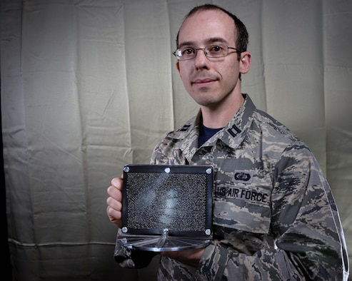 "Capt. Daniel Stambovsky, a physicist assigned to the 32nd Intelligence Squadron at Fort Meade, Maryland, recently received notification that two of patents from his previous assignment at the Air Force Research Laboratory in Rome, New York, have been processed and approved: the ""Actuated Pin Antenna Reflector"" and the ""Radio Frequency Emissive Display Antenna and System for Controlling."" (U.S. Air Force photo/Staff Sgt. Alexandre Montes)"