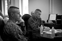 U.S. Marine Corps Col. David P. Grant, left, commanding officer of Marine Corps Combat Service Support Schools (MCCSSS), and Brig. Gen. Jason Q. Bohm, commanding general of Training Command, recieve a brief from Train the Trainer School during Bohm's visit to Camp Johnson, N.C., March 1, 2017. Brig. Gen. Bohm's visit was to observe and discuss how MCCSSS' plans nest with the Training Command Campaign Plan and to review progress on the Leadership Development Program, reading and writing programs, and employment of Force Fitness Instructors. (U.S. Marine Corps photo by Cpl. Laura Mercado)