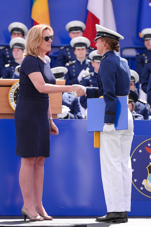 Second Lt. Rebecca Esselstein (right), shakes hands with former Secretary of the Air Force Deborah Lee James after receiving her diploma during the 2015 graduation ceremony at the U.S. Air Force Academy. Esselstein was the No. 1 graduate in the Class of 2015. (U.S. Air Force photo/Mike Kaplan)