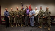 U.S. Marine Corps Brig. Gen. Jason Q. Bohm, commanding general of Training Command, fourth from the left, poses for a photo with civilians and Marines of Marine Corps Combat Service Support Schools (MCCSSS) during his visit to Camp Johnson, N.C., March 1, 2017. Brig. Gen. Bohm's visit was to observe and discuss how MCCSSS' plans nest with the Training Command Campaign Plan and to review progress on the Leadership Development Program, reading and writing programs, and employment of Force Fitness Instructors. (U.S. Marine Corps photo by Cpl. Laura Mercado)