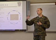 U.S. Marine Corps Lt. Col. Douglas Burke, commanding officer of Ground Supply School, Marine Corps Combat Service Support Schools (MCCSSS), briefs Marines from MCCSSS and Brig. Gen. Jason Q. Bohm, commanding general of Training Command, during Bohm's visit to Camp Johnson, N.C., March 1, 2017. Brig. Gen. Bohm's visit was to observe and discuss how MCCSSS' plans nest with the Training Command Campaign Plan and to review progress on the Leadership Development Program, reading and writing programs, and employment of Force Fitness Instructors. (U.S. Marine Corps photo by Cpl. Laura Mercado)