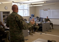 U.S. Marine Corps Lt. Col. Keith Warren, commanding officer of Logistics Operations School, Marine Corps Combat Service Support Schools (MCCSSS), briefs Marines from MCCSSS and Brig. Gen. Jason Q. Bohm, commanding general of Training Command, during Bohm's visit to Camp Johnson, N.C., March 1, 2017. Brig. Gen. Bohm's visit was to observe and discuss how MCCSSS' plans nest with the Training Command Campaign Plan and to review progress on the Leadership Development Program, reading and writing programs, and employment of Force Fitness Instructors. (U.S. Marine Corps photo by Cpl. Laura Mercado)