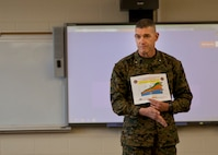 U.S. Marine Corps Brig. Gen. Jason Q. Bohm, commanding general of Training Command, addresses Marines of Marine Corps Combat Service Support Schools (MCCSSS) during his visit to Camp Johnson, N.C., March 1, 2017. Brig. Gen. Bohm's visit was to observe and discuss how MCCSSS' plans nest with the Training Command Campaign Plan and to review progress on the Leadership Development Program, reading and writing programs, and employment of Force Fitness Instructors. (U.S. Marine Corps photo by Cpl. Laura Mercado)