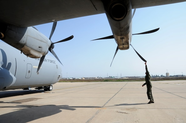 Iraqi air force Maj. Diya Majid, a pilot, inspects a C-130J Super Hercules propeller March 20, 2017, at Martyr Muhammad Alaa Air Base, Iraq. The aircraft is used by the Iraqi Air Force to move cargo and personnel downrange in the fight against the Islamic State of Iraq and Syria. (U.S. Air Force photo/Tech. Sgt. Kenneth McCann)