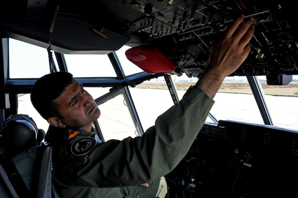 Iraqi Air Force Maj. Diya Majid, pilot, performs pre-flight inspections on a C-130J Super Hercules at Martyr Muhammad Alaa Air Base, Iraq, March 20 2017. Majid trains with the 370th  Air Expeditionary Advisory Squadron to improve his knowledge of the aircraft. (U.S. Air Force photo/Tech. Sgt. Kenneth McCann)