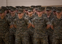 U.S. Marine Corps Pfc. Maria Daume, center, a mortarman assigned to Bravo Company, Infantry Training Battalion, School of Infantry-East,  graduates from the Basic Mortarman course aboard Camp Geiger, N.C., March 23, 2017. The purpose of the Mortarman is to provide fire in support of maneuver elements using light, medium, and heavy mortars. (U.S. Marine Corps photo by Cpl. Laura Mercado)