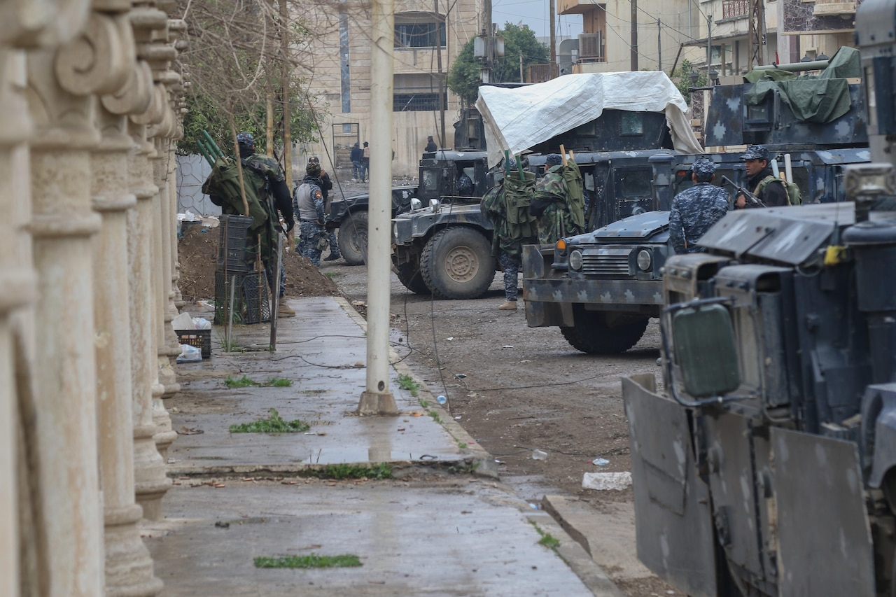 Iraqi federal police secure a city street in West Mosul, Iraq, March 2, 2017. The breadth and diversity of partners supporting the coalition demonstrate the global and unified nature of the endeavor to defeat the Islamic State of Iraq and Syria. Combined Joint Task Force Operation Inherent Resolve is the global coalition to defeat ISIS in Iraq and Syria. Army photo by Staff Sgt. Jason Hull