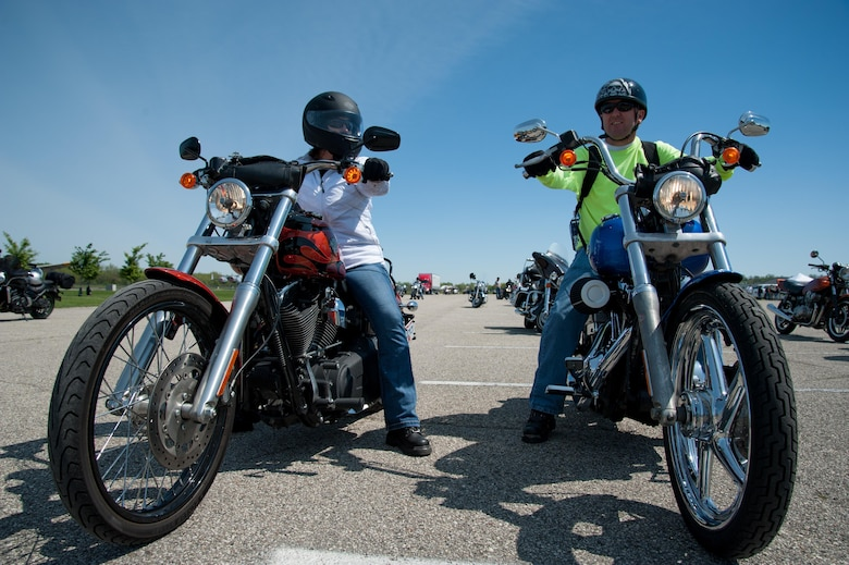 Tech Sgt. Wayne McNutt, National Air and Space Intelligence Center intelligence analyst (right), waits with his wife, Angela, before heading out on one of the group rides as part of Wright-Patterson Motorcycle Safety Day held at the National Museum of the United States Air Force May 6, 2016. (U.S. Air Force photo/John Harrington)