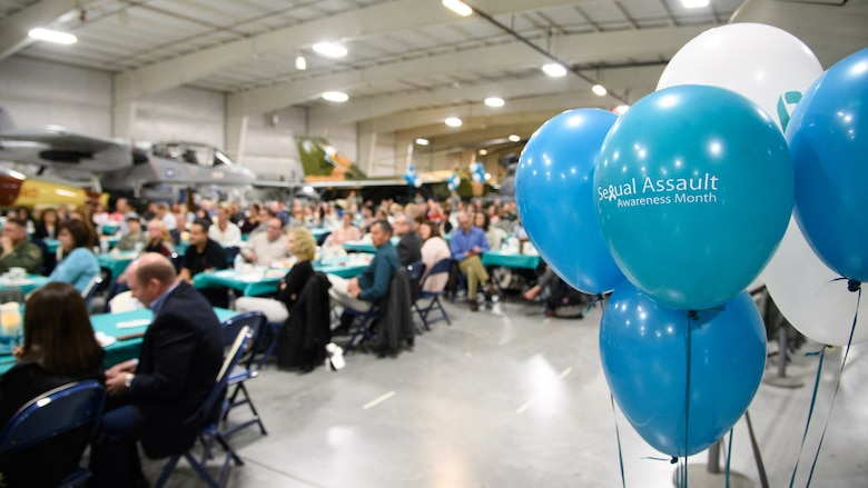 Community members and Hill Air Force Base personnel listen to a guest speaker during the second annual Sexual Assault and Prevention Month Breakfast at the Hill Aerospace Museum, April 4, 2017. The event kicked off Sexual Assault Awareness and Prevention Month and was attended by nearly 200 guests. (U.S. Air Force photo/R. Nial Bradshaw)