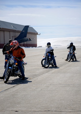 Students of a beginner motorcycle course held at Pease Air National Guard Base, N.H. learn how to park their bikes April 3, 2017.