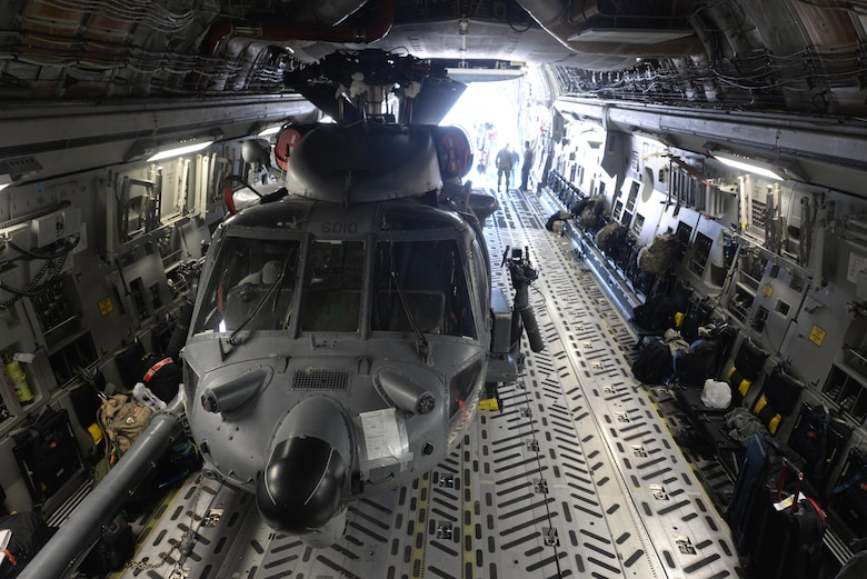 An HH-60 Pave Hawk helicopter, assigned to the 34th Weapons Squadron, sits inside a C-17 Globemaster III, assigned to the 57th Weapons Squadron, McChord Air Force Base, Wash., at Nellis Air Force Base, Nev., March 28, 2017. The HH-60 is the primary search-and-rescue helicopter for the Air Force, and can also be tasked with disaster and humanitarian relief missions. (U.S. Air Force photo by Airman 1st Class Andrew D. Sarver/ Released)