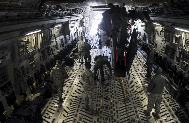 Airman from the 34th Weapons Squadron, secure a HH-60 Pave Hawk in the cargo area of a C-17 Globemaster III assigned to the 57th Weapons Squadron, McChord Air Force Base, Wash., March 28, 2017. The C-17 is capable of rapid strategic delivery of troops and all types of cargo to main operating bases or directly to forward bases in the deployment area. (U.S. Air Force photo by Airman 1st Class Kevin Tanenbaum/Released)