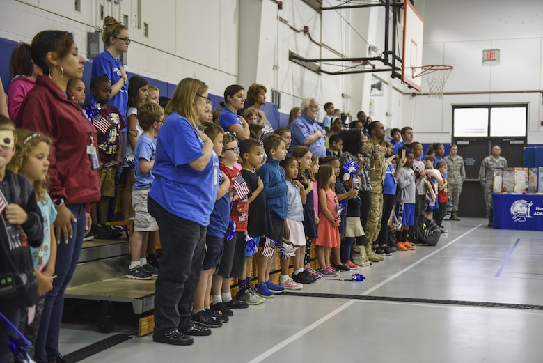 Children and family members from the Hurlburt Youth Center stand for the National Anthem during the Month of the Military Child and Child Abuse Prevention Month proclamation signing ceremony at the Youth Center, Hurlburt Field, Fla., April 3, 2017. April is designated as the MOMC, underscoring the important role military children play in the armed forces community. (U.S. Air Force photo by Senior Airman Jeff Parkinson)