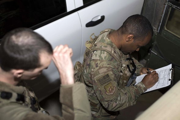 Senior Airman Michael Ripple, 791st Missile Security Forces Squadron response force leader and Staff Sgt. Calvin Smith, 91st Missile Security Force Squadron flight security controller, review a pre-mission vehicle checklist at Minot Air Force Base, N.D., Mar. 28, 2017. Vehicle checks help prevent breakdowns and identify other potential problems. (U.S. Air Force photo/Airman 1st Class Austin M. Thomas)