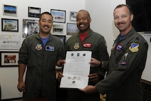 The 6th Attack Squadron commander (left), 29th Attack Squadron commander, and 9th Attack Squadron commander, display the Reaper Armistice Agreement after they signed the document March 31, 2017, at Holloman Air Force Base, N.M. The Reaper Armistice Agreement is an esprit de corps arrangement between the three squadrons that marks the neutral time when the capture of non-mission essential belongings from a different attack squadron, in the name of competitive spirit, isn't allowed at Holloman AFB. (U.S. Air Force photo by Master Sgt. Matthew McGovern)