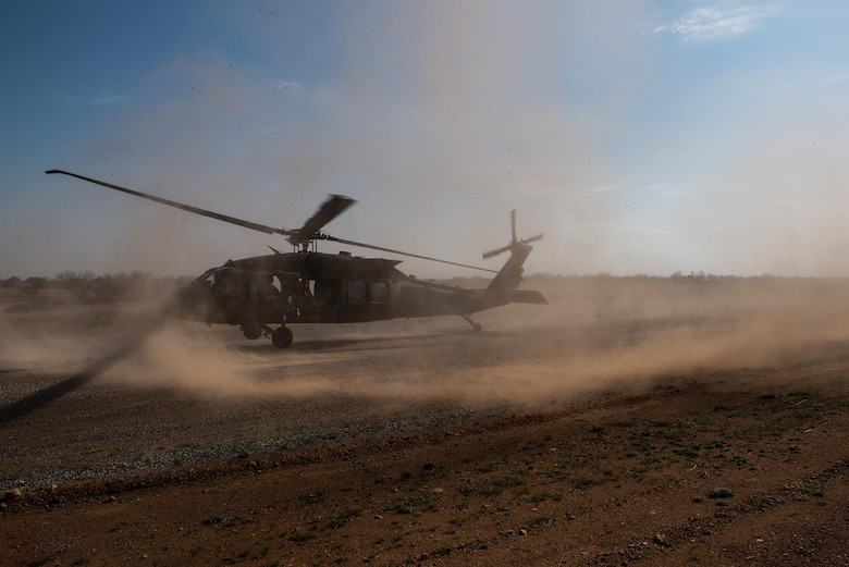 A UH-60 Black Hawk helicopter prepares to land and extract Special Tactics Airmen for the 123rd Special Tactics Squadron, Kentucky Air National Guard, and one Public Affairs Airman from Falcon Bombing Range, Fort Sill, Okla., March 22, 2017. The 137th Air Support Element from the 137th Special Operations Wing, Oklahoma City, coordinated a joint training event with the 123rd Special Tactics Squadron, Kentucky Air National Guard, Air Force Reserve F-16 Fighting Falcons from the 301st Fighter Wing and T-38 Talons from the 88th Fighter Training Squadron, Sheppard Air Force Base, March 20-23, 2017. (U.S. Air National Guard photo by Senior Master Sgt. Andrew M. LaMoreaux/Released)