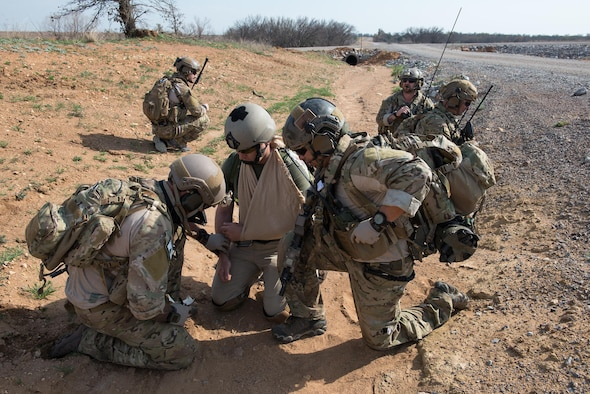 Pararescue Airmen from the 123rd Special Tactics Squadron, Kentucky Air National Guard, provide simulated first-aid to a simulated wound during a joint training event at Falcon Bombing Range, Fort Sill, Okla., March 22, 2017. The 137th Air Support Element from the 137th Special Operations Wing, Oklahoma City, coordinated a joint training event with the 123rd Special Tactics Squadron, Kentucky Air National Guard, Air Force Reserve F-16 Fighting Falcons from the 301st Fighter Wing and T-38 Talons from the 88th Fighter Training Squadron, Sheppard Air Force Base, March 20-23, 2017. (U.S. Air National Guard photo by Senior Master Sgt. Andrew M. LaMoreaux/Released)