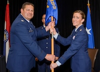 Maj. Rachel Savage receives the 131st Logistics Readiness Squadron guidon from Col. Michael Jurries, 131st Mission Support Group commander, during the assumption of command ceremony at Whiteman Air Force Base, Missouri, April 1, 2017. (U.S. Air National Guard photo by Tech. Sgt. Traci Howells)