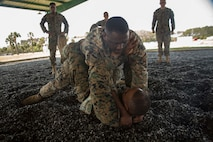 Sergeant Maurkees D. Wright, top, grapples with Staff Sgt. Wi McMullen during MCMAP training aboard Marine Corps Recruit Depot Parris Island, South Carolina, Apr. 5, 2017. MCMAP is a martial arts style in the Marine Corps that is a mixture of mixed martial arts and Judo. (U.S. Marine Corps photo by Lance Cpl. Jack A. E. Rigsby/Released)