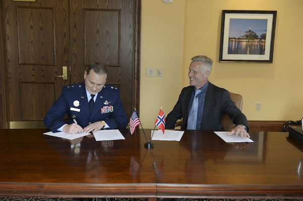 U.S. Air Force Maj. Gen. Clinton E. Crosier (left), U.S. Strategic Command (USSTRATCOM) director of plans and policy, signs a memorandum of understanding at the 33rd Annual Space Symposium, Apr. 4, 2017, with Royal Norwegian Air Force Col. Stig Nilsson (right), Norwegian Ministry of Defence head of the space program. The memorandum – previously signed by Norwegian Army Maj. Gen. Odd-Harald Hagen, Norwegian Ministry of Defence Department of Defence Policy and Long-Term Planning director general, and Arne Benjaminsen, Norwegian Ministry of Trade, Industry and Fisheries Research and Innovation Department director general, in Oslo, Norway, March 1, 2017 – authorizes sharing space situational awareness (SSA) services and information with the Norwegian Ministry of Defence and Norwegian Ministry of Trade, Industry and Fisheries. Norway joins 12 nations (the United Kingdom, the Republic of Korea, France, Canada, Italy, Japan, Israel, Spain, Germany, Australia, the United Arab Emirates and Belgium), two intergovernmental organizations (the European Space Agency and the European Organization for the Exploitation of Meteorological Satellites) and more than 60 commercial satellite owner/operator/launchers already participating in SSA data-sharing agreements with USSTRATCOM. SSA data-sharing agreements enhance multinational space cooperation and streamline the process for USSTRATCOM partners to request specific information gathered by USSTRATCOM's Joint Space Operations Center at Vandenberg Air Force Base, Calif.