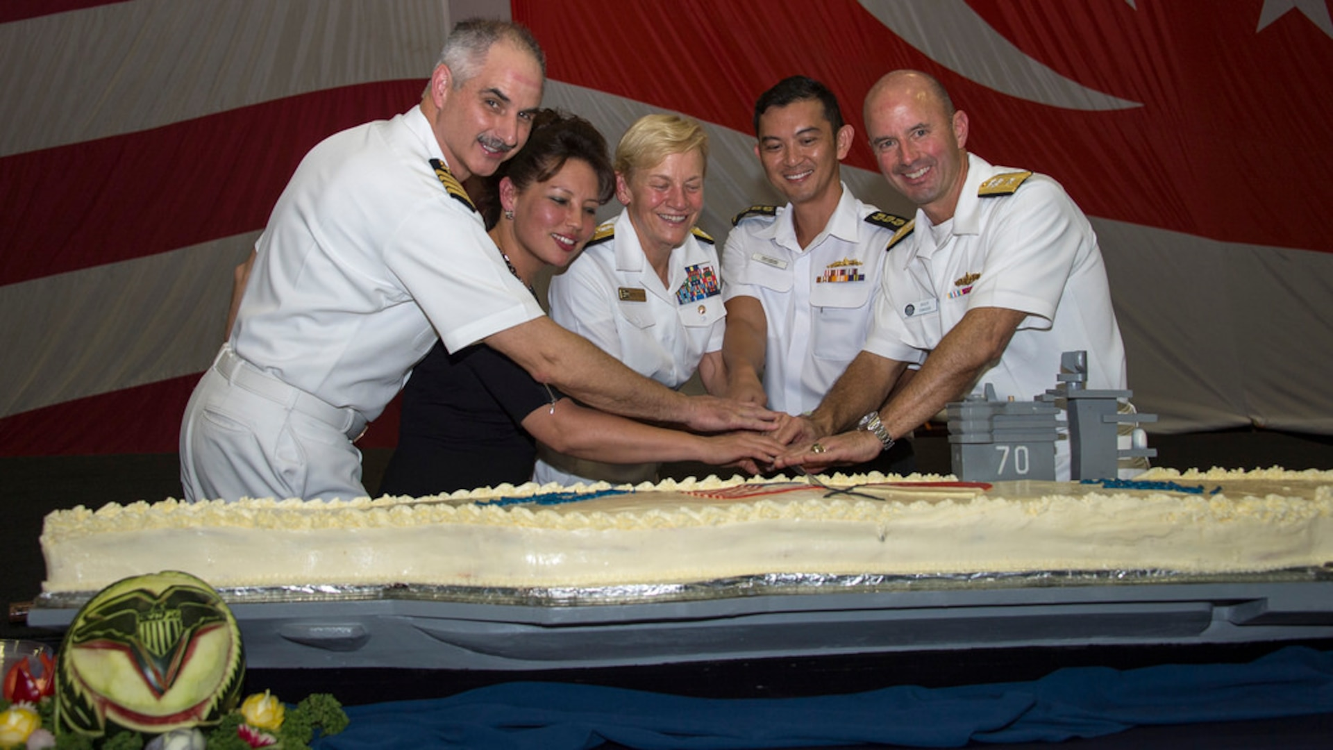 (left to right) USS Carl Vinson (CVN 70) commanding officer Capt. Doug Verissimo; Chargé d'Affaires, ad interim, U.S. Embassy Singapore Stephanie Syptak-Ramnath; Commander, U.S. Third Fleet Vice Adm. Nora Tyson; Commander, Singapore Fleet, Col. Cheong Kwok Chien; and Commander, Carrier Strike Group 1 Rear Adm. Jim Kilby cut the cake during a Singapore reception aboard the aircraft carrier USS Carl Vinson (CVN 70), April 4, 2017. The Carl Vinson Strike Group is on a regularly scheduled Western Pacific deployment as part of the U.S. Pacific Fleet-led initiative to extend the command and control functions of U.S. 3rd Fleet. U.S. Navy aircraft carrier strike groups have patrolled the Indo-Asia-Pacific regularly and routinely for more than 70 years.