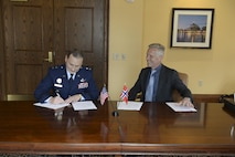 U.S. Air Force Maj. Gen. Clinton E. Crosier, the U.S. Strategic Command (USSTRATCOM) director of plans and policy, signs a memorandum of understanding with Royal Norwegian Air Force Col. Stig Nilsson, the Norwegian Ministry of Defense head of the space program, April 4, 2017, at the 33rd Annual Space Symposium, Colorado Springs, Colorado. The memorandum authorizes sharing space situational awareness (SSA) services and information with the Norwegian Ministry of Defense and Norwegian Ministry of Trade, Industry and Fisheries. (U.S. Air Force photo/ David Grim)
