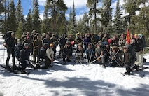 Company A, Marine Cryptologic Support Battalion and 460th Force Support Squadron Outdoor Recreation instructors from Buckley Air Force Base, Colo., pose for a photo near Beaver Meadows Resort Ranch April 2, 2017. The unit spent three days learning winter survival skills in cold-weather conditions. (U.S. Air Force photo by Airman Jacob Deatherage/Released)