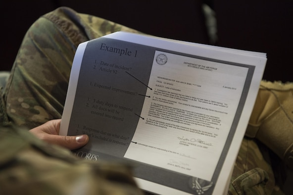An Airman holds an informational handout during a Military Justice 101: Administrative Paperwork class at F.E. Warren Air Force Base, Wyo., April 5, 2017. The class covered topics such as writing letters of counseling and reprimand, and detailed the mistakes which are often made by supervisors and commanders. (U.S. Air Force photo by Staff Sgt. Christopher Ruano)